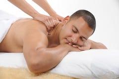 Massagem de obtenção masculina nova Foto de Stock Royalty Free