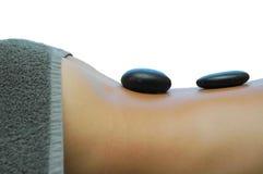 Massagem de pedra quente Fotografia de Stock