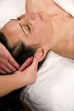 Massagem do Auricle Foto de Stock Royalty Free