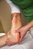 Massagem reflexo da zona do pé Fotografia de Stock