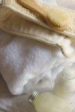 Massager en handdoek Stock Foto's