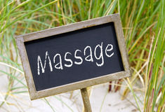 Massageteken op strand Stock Foto