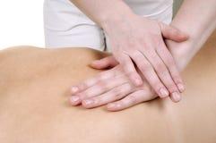 Massaggi la parte posteriore di una donna Immagini Stock