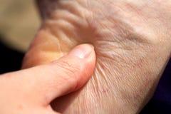 Massaggio al tallone del piede Immagine Stock