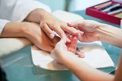 Massaggio delicato delle mani Fotografia Stock