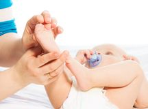 Massaging baby foot Stock Photos