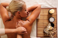 Massaging  back of a beautiful young female Royalty Free Stock Photo