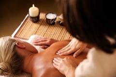 Massaging  backbone of woman Stock Images
