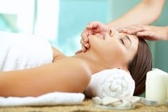 Massaging face royalty free stock photo