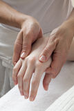 Massaging hand at the spa Stock Images