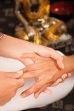 Massaging hands Stock Photos