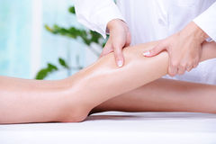 Massaging of the human leg Royalty Free Stock Images