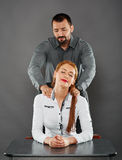 Massaging the lady boss stock image
