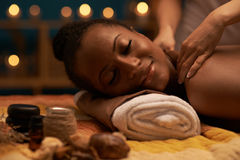 Massaging nape of neck Royalty Free Stock Photography