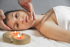 Massaging, portrait of young beautiful woman in spa environment Stock Photos