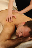 Massaging Young Man at Day Spa Stock Photos