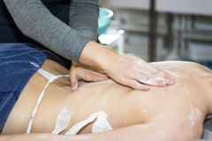 Massaging of young woman. In SPA Stock Images