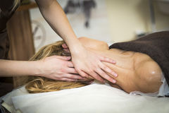 Massaging of young woman. In SPA Stock Photo