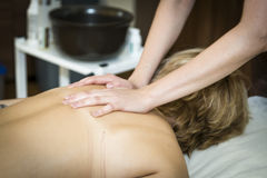 Massaging of young woman. In SPA Royalty Free Stock Photography