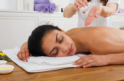 Massagist make oil body massage in spa wellness center Stock Image