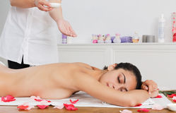 Massagist make oil body massage in spa wellness center Stock Photo