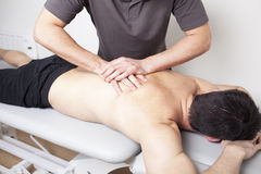 Massagist working Royalty Free Stock Photos