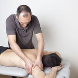 Massagist working Stock Images
