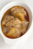 Massaman chicken curry on white fabric Royalty Free Stock Photography