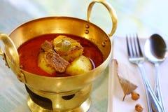 Massamun curry served in beautiful brass wok set. royalty free stock photo