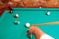 Masse' Shot For The Win. A high angle on the cue to perform the tricky masse' shot to sink the eight ball for the win Royalty Free Stock Photos
