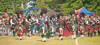 Massed pipe bands at Forres Games Stock Photo