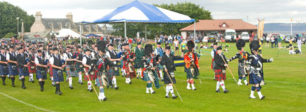 Massed Pipe Bands Marching At Nairn. Royalty Free Stock Photography