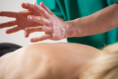 Masseur doing back massage Stock Image