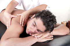 Masseur doing back massage on man body Royalty Free Stock Photos