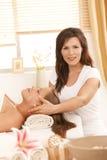 Masseur doing facial massage royalty free stock photos