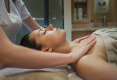 Masseur doing facial massage of an adult woman Royalty Free Stock Photography