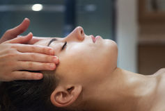 Masseur doing facial massage of an adult woman. In the spa salon Stock Image