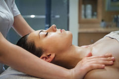 Masseur doing facial massage of the young woman Stock Images