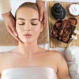 Masseur doing haed massage. Closeup portrait royalty free stock photos