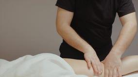 Masseur doing leg hip anti cellulite massage. Woman body rejuvenating procedure