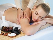 Masseur doing massage of body stock image