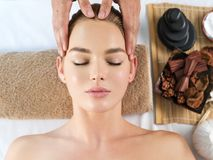 Masseur doing massage the head royalty free stock photography