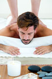 Masseur doing massage on man body in the spa salon. royalty free stock images