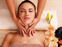 Masseur doing massage the neck of an woman in spa salon Stock Photos