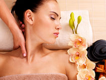 Masseur doing massage the neck of an woman in spa salon. Masseur doing massage the neck of an adult woman in the spa salon Royalty Free Stock Image