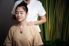 Masseur doing massage spa with treatment on Asian woman body in the Thai spa lifestyle, so relax and luxury. Masseur doing massage spa with treatment on Asian stock image