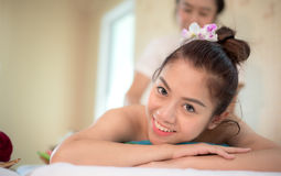 Masseur doing massage spa with treatment on Asian woman body in the Thai spa lifestyle, so relax and luxury. Masseur doing massage spa with treatment on Asian royalty free stock photography