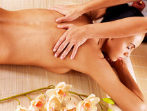 Masseur doing massage on woman back in spa salon. Masseur doing massage on woman back in the spa salon Stock Photo