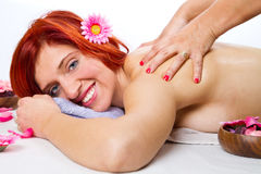 Masseur doing massage on woman body in the spa salon Royalty Free Stock Photography
