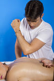 Masseur doing massage on woman body in the spa salon. Beauty tre Stock Photos